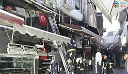 İş hanındaki dükkanda çıkan yangın diğer dükkanlara sıçramadan söndürüldü