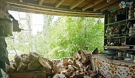 Yabancı uyruklu ailenin kaldığı evin duvarı yıkıldı